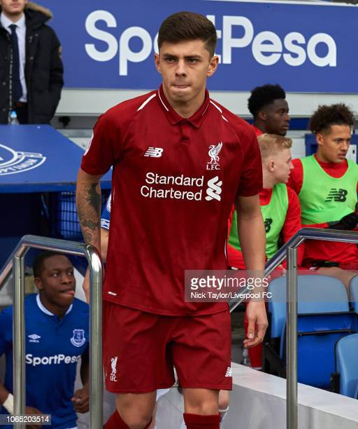Adam Lewis of Liverpool makes his way to the pitch at the start of the PL2 game at Goodison Park on November 25 2018 in Liverpool England