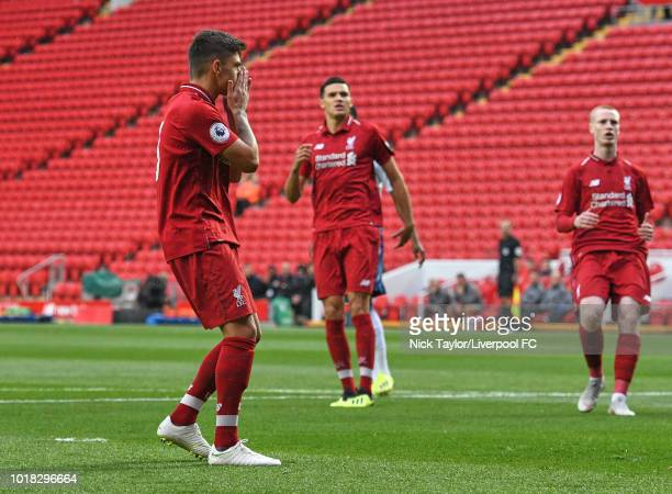 Adam Lewis of Liverpool reacts to his miss from the penalty spot during the Liverpool v Tottenham Hotspur PL2 game at Anfield on August 17 2018 in...
