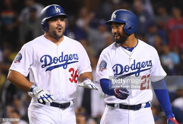 Adam Liberatore catches his breath as he walks to the dugout with Matt Kemp of the Los Angeles Dodgers after scoring a run from first base in the...