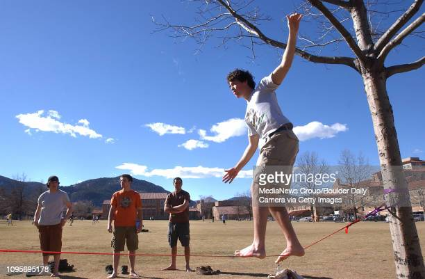 Adam Lightman a freshman at the University of Colorado took his shoes off in the warm weather Monday and tackled a slack line that was strung up...