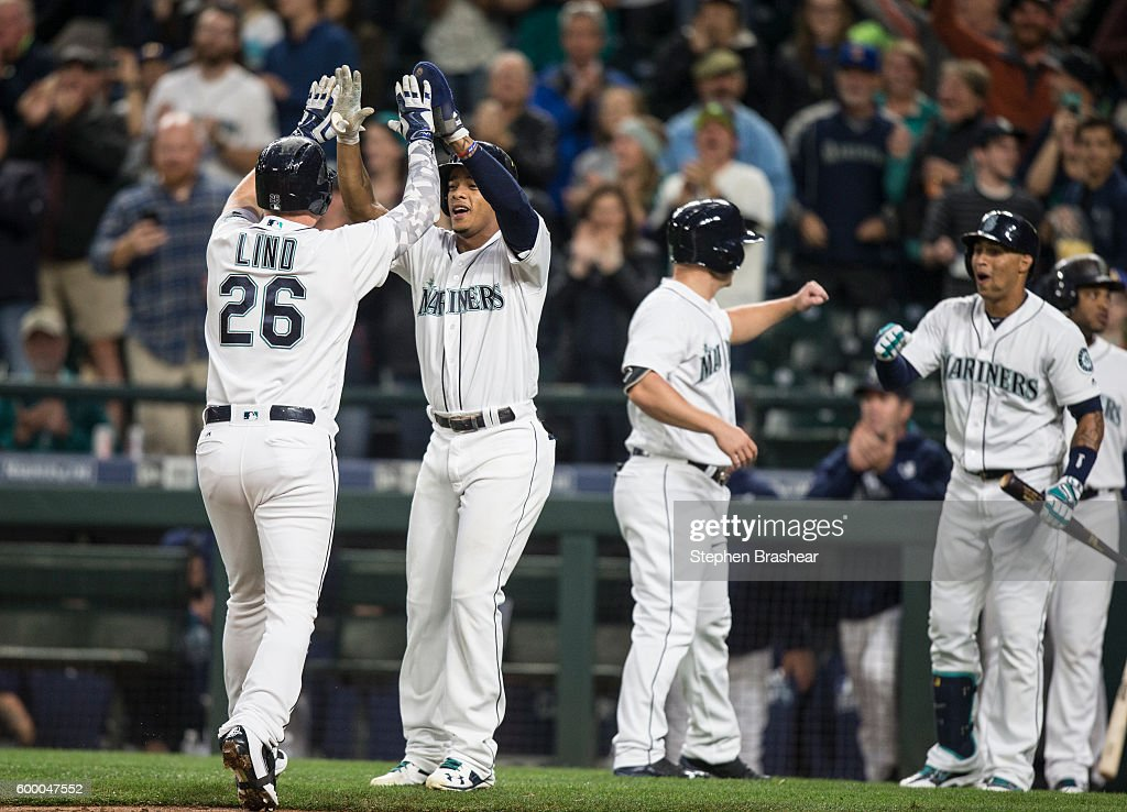 Adam Lind #26, Ketel Marte #4, Kyle Seager #15 and Leonys Martin #12 of the Seattle Mariners celebrate a grand slam home run hit by Lind off of A.J. Griffin #64 of the Texas Rangers that scored Marte and Seager during the first inning of a game at Safeco Field on September 7, 2016 in Seattle, Washington.