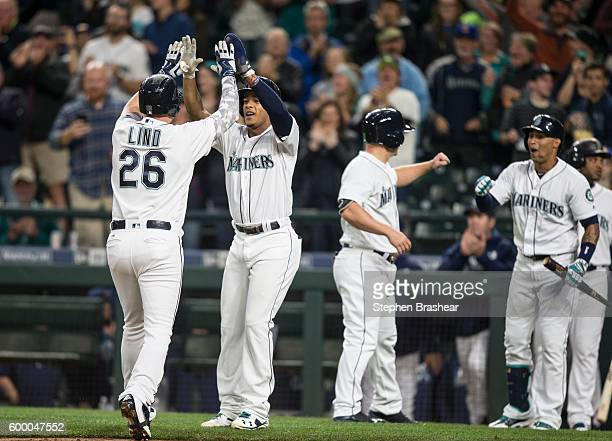 Adam Lind Ketel Marte Kyle Seager and Leonys Martin of the Seattle Mariners celebrate a grand slam home run hit by Lind off of AJ Griffin of the...