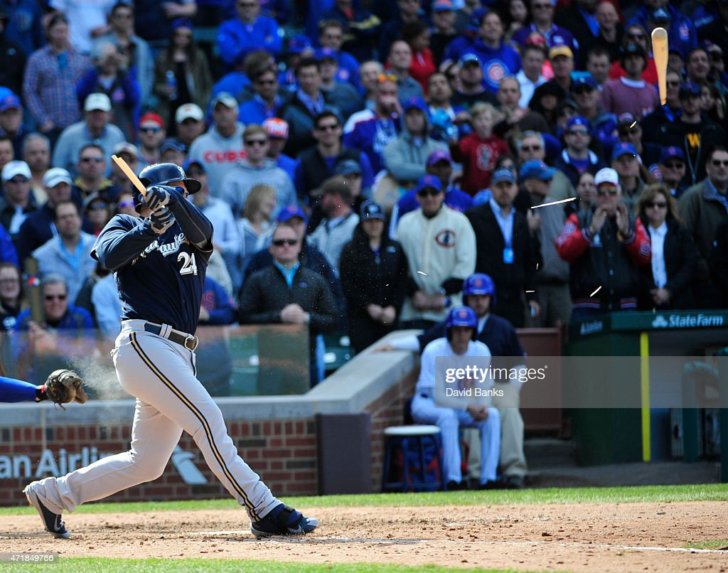 Adam Lind #24 of the Milwaukee Brewers breaks his bat as he makes the final out against the Chicago Cubs on May 1, 2015 at Wrigley Field in Chicago, Illinois. The Cubs defeated the Brewers 1-0.