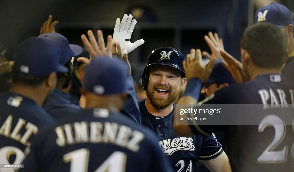 Adam Lind #24 of the Milwaukee Brewers reacts with teammates after his two run home run against the Colorado Rockies in the third inning at Miller Park on April 8, 2015 in Milwaukee, Wisconsin.