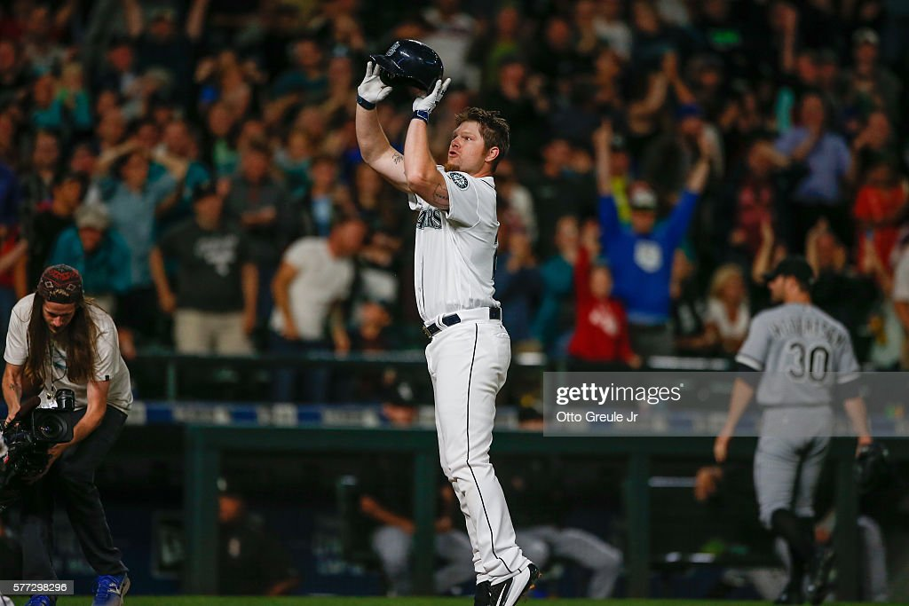 Adam Lind #26 of the Seattle Mariners 'jump shoots' his helmet as he crosses home plate following a 3-run walk off home run to beat the Chicago White Sox 4-3 at Safeco Field on July 18, 2016 in Seattle, Washington.