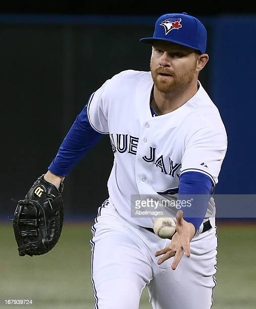 Adam Lind of the Toronto Blue Jays makes the play to first gainst the Boston Red Sox at the Rogers Cente May 2 2013 in Toronto Ontario Canada