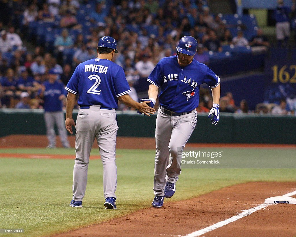 Adam Lind #26 of the Toronto Blue Jays runs the bases after hitting a home run in the sixth inning against the Tampa Bay Rays during the game on August 17, 2013 at Tropicana Field in St. Petersburg, Florida.