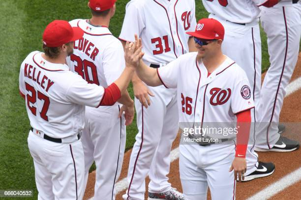 Adam Lind of the Washington Nationals and Shawn Kelley are introduced on opening day before the game against the Miami Marlins at Nationals Park on...