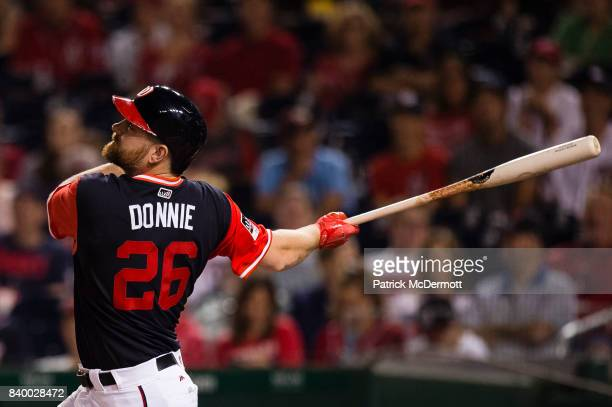 Adam Lind of the Washington Nationals hits a fly ball out to left in the second inning against the New York Mets during Game Two of a doubleheader at...
