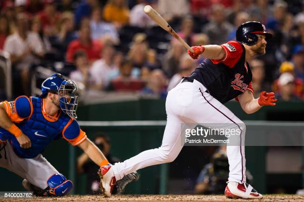 Adam Lind of the Washington Nationals hits a RBI sacrifice fly to center scoring Daniel Murphy in the fourth inning against the New York Mets during...