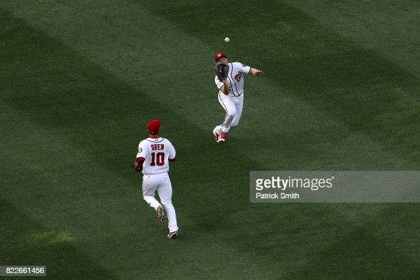 Adam Lind of the Washington Nationals makes a catch on a hit by Ryan Braun of the Milwaukee Brewers during the first inning at Nationals Park on July...