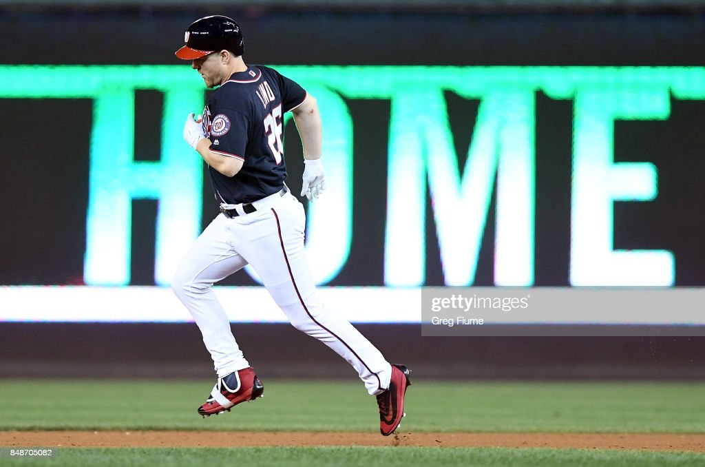 Adam Lind #26 of the Washington Nationals rounds the bases after hitting a home run in the eighth inning against the Los Angeles Dodgers at Nationals Park on September 17, 2017 in Washington, DC.