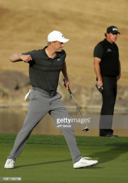 Adam Long of the United States celebrates after making the winning putt on the 18th green during the final round of the Desert Classic at the Stadium...