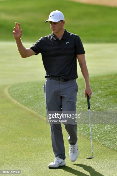 Adam Long of the United States makes a birdie putt on the 2nd hole during the final round of the Desert Classic at the Stadium Course on January 20...