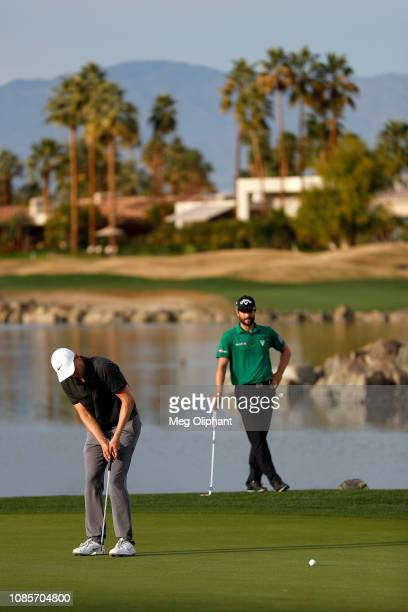 Adam Long of the United States makes the winning putt on the 18th hole during the final round of the Desert Classic at the Stadium Course on January...