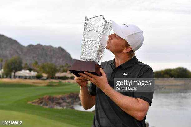 Adam Long of the United States poses with the trophy after winning the Desert Classic at the Stadium Course on January 20 2019 in La Quinta California