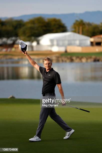 Adam Long of the United States reacts after making the winning putt on the 18th hole during the final round of the Desert Classic at the Stadium...