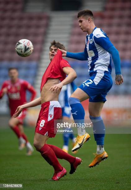 Adam Long of Wigan Athletic and Mike Calveley of Chorley FC in action during the FA Cup First Round match between Wigan Athletic and Chorley on...