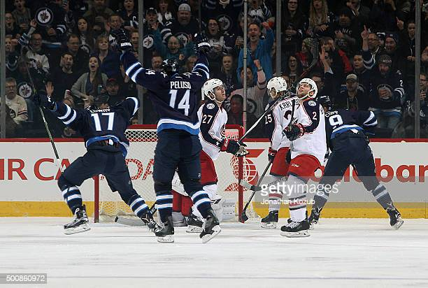 Adam Lowry and Anthony Peluso of the Winnipeg Jets celebrate Lowry's first period goal against the Columbus Blue Jackets at the MTS Centre on...