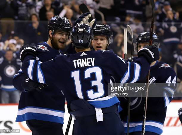 Adam Lowry Brandon Tanev Andrew Copp and Josh Morrissey of the Winnipeg Jets celebrate a second period goal against the St Louis Blues at the Bell...