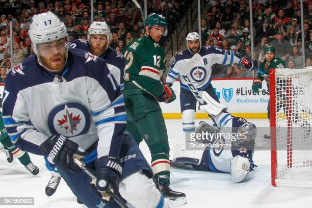 Adam Lowry Joe Morrow Dustin Byfuglien and Connor Hellebuyck of the Winnipeg Jets defend against Eric Staal of the Minnesota Wild in Game Four of the...