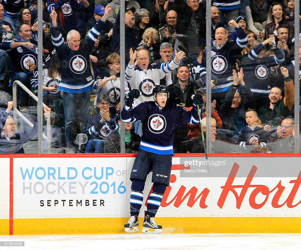 Adam Lowry #17 of the Winnipeg Jets celebrates his third period goal against the Vancouver Canucks at the MTS Centre on March 22, 2016 in Winnipeg, Manitoba, Canada.