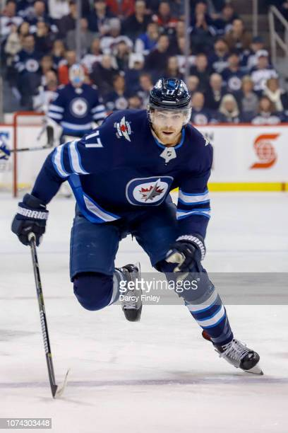 Adam Lowry of the Winnipeg Jets follows the play down the ice during first period action against the Tampa Bay Lightning at the Bell MTS Place on...