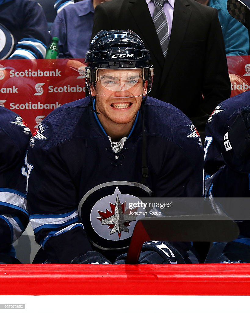 Adam Lowry #17 of the Winnipeg Jets is all smiles on the bench as he awaits puck drop against the Edmonton Oilers at the MTS Centre on December 1, 2016 in Winnipeg, Manitoba, Canada.