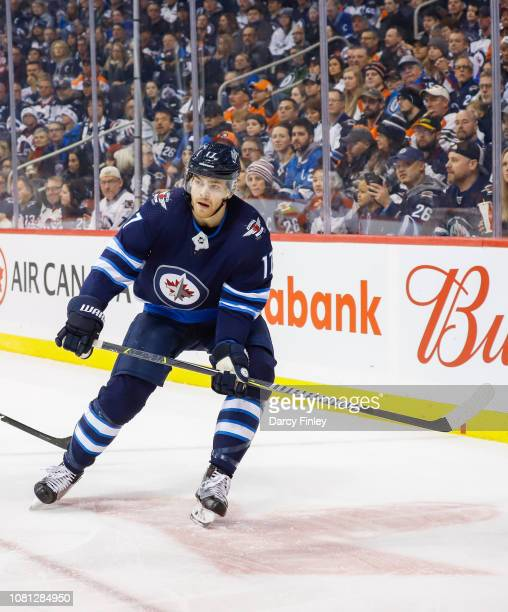 Adam Lowry of the Winnipeg Jets keeps an eye on the play during first period action against the Philadelphia Flyers at the Bell MTS Place on December...