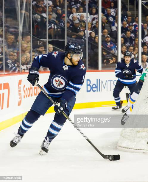 Adam Lowry of the Winnipeg Jets plays the puck around the net during second period action against the St Louis Blues at the Bell MTS Place on October...