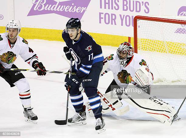 Adam Lowry of the Winnipeg Jets sets a screen in front of goaltender Corey Crawford of the Chicago Blackhawks during second period action at the MTS...