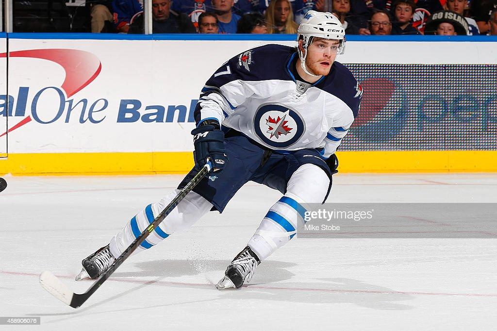 Adam Lowry #17 of the Winnipeg Jets skates against the New York Islanders at Nassau Veterans Memorial Coliseum on October 28, 2014 in Uniondale, New York. The Winnipeg Jets defeated the New York Islanders 4-3.