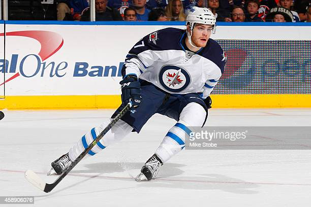 Adam Lowry of the Winnipeg Jets skates against the New York Islanders at Nassau Veterans Memorial Coliseum on October 28, 2014 in Uniondale, New...