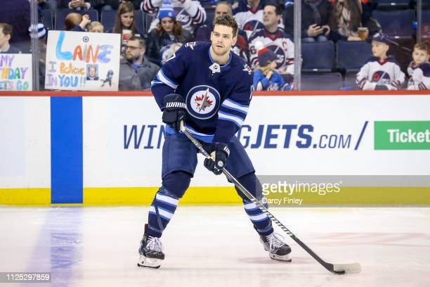 Adam Lowry of the Winnipeg Jets takes part in the pregame warm up prior to NHL action against the Ottawa Senators at the Bell MTS Place on February...