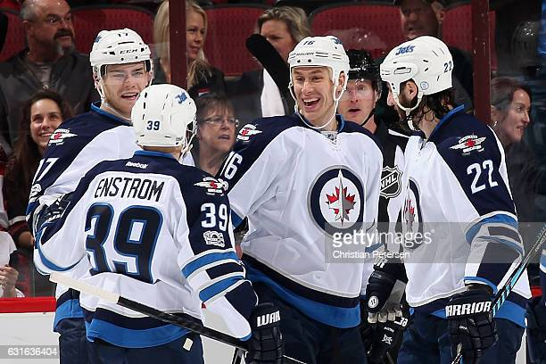 Adam Lowry Toby Enstrom Shawn Matthias and Chris Thorburn of the Winnipeg Jets celebrate after Matthias scored a goal against the Arizona Coyotes...