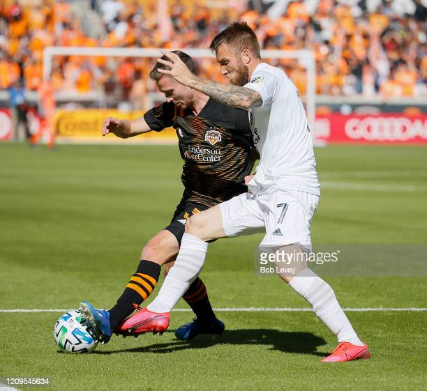 Adam Lundqvist of Houston Dynamo holds off Aleksander Katai of Los Angeles Galaxy as he attempts to keep possession of the ball at BBVA Stadium on...