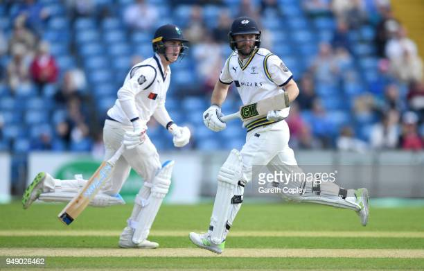 Adam Lyth and Harry Brook of Yorkshire score runs during the Specsavers County Championship Division One match between Yorkshire and Nottinghamshire...