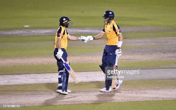 Adam Lyth fist pumps Joe Root of Yorkshire Vikings during the T20 Vitality Blast 2020 match between Lancashire Lightning and Yorkshire Vikings at...