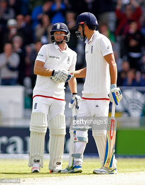 Adam Lyth is congratulated by Alastair Cook of England for scoring 50 runs during day two of the England v New Zealand 2nd Investec Test match at...
