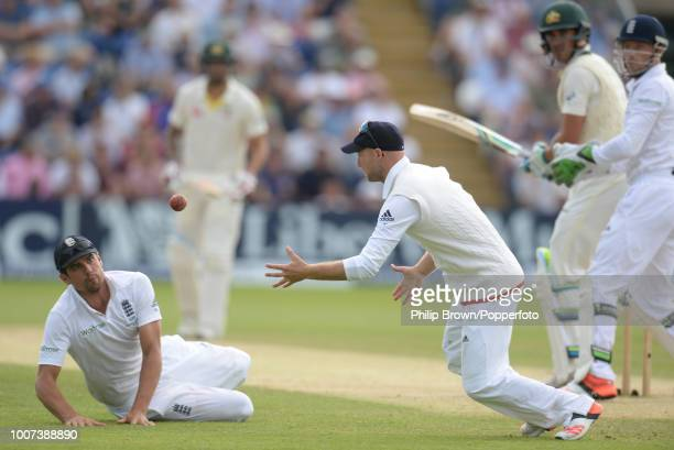 Adam Lyth of England reaches to catch the ball parried by Alastair Cook to dismiss Mitchell Starc of Australia during the 1st Ashes Test match...