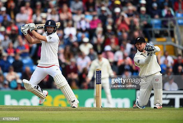 Adam Lyth of England smashes the ball to the boundary in front of Luke Ronchi of New Zealand during day two of the 2nd Investec Test Match between...