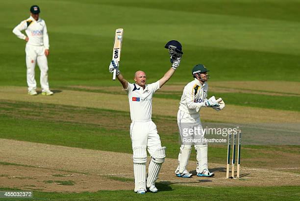 Adam Lyth of Yorkshire celebrates as he reaches his century during the first day of the LV County Championship match between Nottinghamshire and...