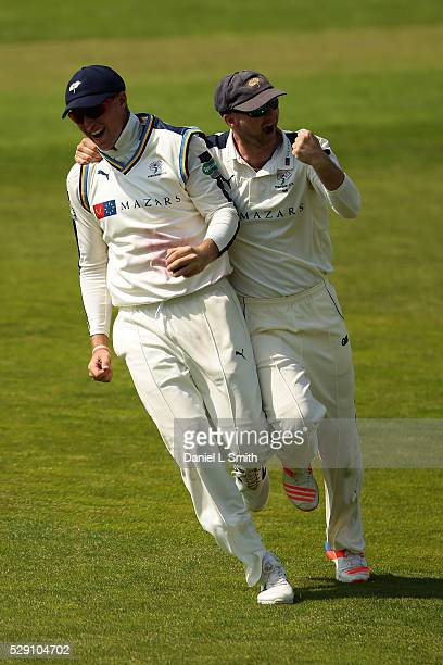 Adam Lyth of Yorkshire celebrates with Joe Root or Yorkshire after catchin the ball from Jason Roy of Surrey during the Specsavers County...