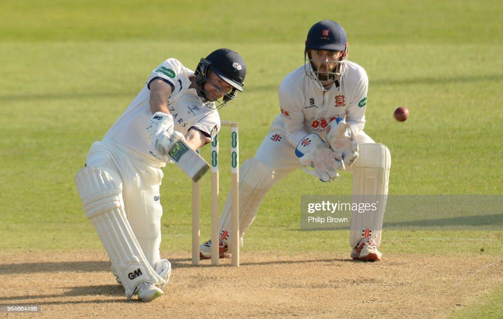 Adam Lyth of Yorkshire hits a four watched by James Fosterof Essex during day one of the Specsavers County Championship Division One cricket match between Essex and Yorkshire at the Cloudfm county ground on May 4, 2018 in Chelmsford, England.