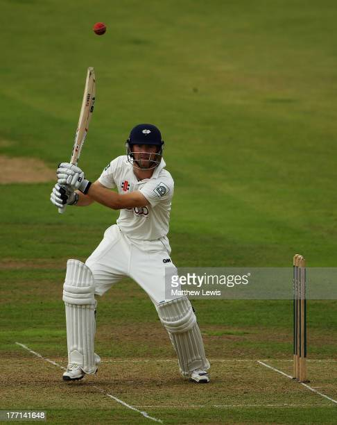 Adam Lyth of Yorkshire hits the ball towards the boundary during day one of the LV County Championship division one match between Nottinghamshire and...