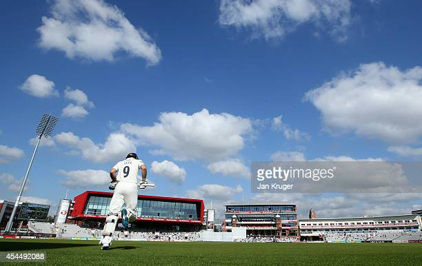 Adam Lyth of Yorkshire makes his way out to bat during the LV County Championship match between Lancashire and Yorkshire at Old Trafford on September...