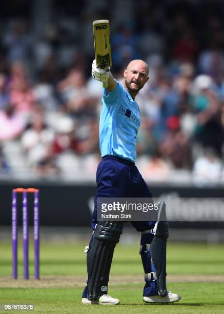 Adam Lyth of Yorkshire raises his bat after scoring 100 runs during the Royal London One Day Cup match between Lancashire and Yorkshire Vikings at...