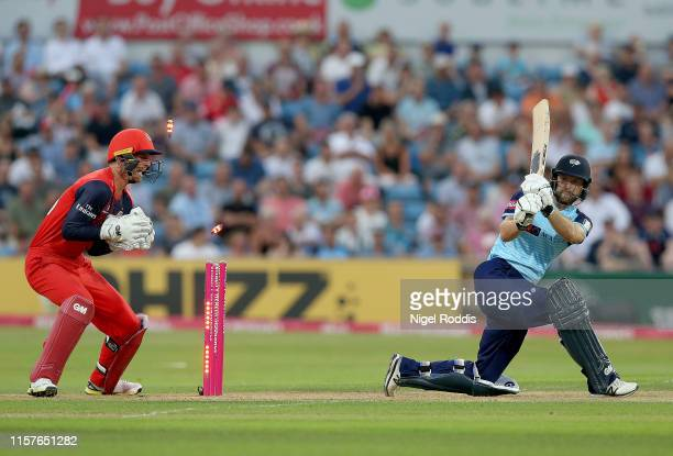 Adam Lyth of Yorkshire Vikings is bowled out by Steven Croft of Lancashire Lightning during the Vitality Blast match between Yorkshire Vikings and...