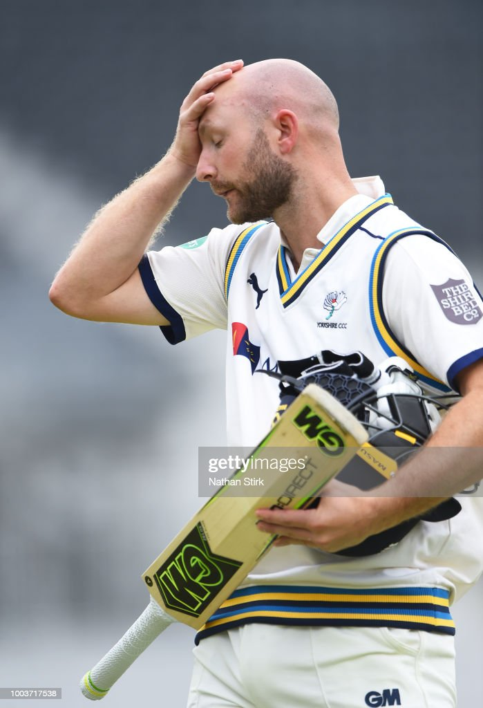 Adam Lyth of Yorkshire walks back the pavilion after getting out by James Anderson of Lancashire during the Specsavers Championship Division One match between Lancashire and Yorkshire at Old Trafford on July 22, 2018 in Manchester, England.