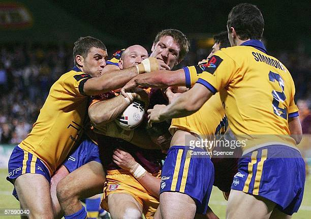 Adam MacDougall of Country is wrapped up by the City defence during the NRL City v Country Origin match at Apex Oval May 12 2006 in Dubbo Australia